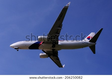 SEPANG, MALAYSIA - JULY 19: Malaysia Airlines plane Boeing 737-8H6, Registration name 9M-MLP, ready to landing at KLIA airport on July 19, 2014 in KLIA, Sepang, Malaysia.  - stock photo
