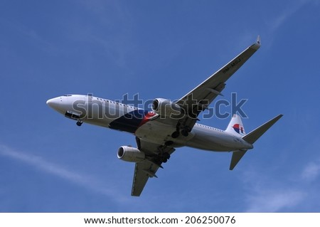 SEPANG, MALAYSIA - JULY 19: Malaysia Airlines plane Boeing 737-8H6, Registration name 9M-MSJ, ready to landing at KLIA airport on July 19, 2014 in KLIA, Sepang, Malaysia.  - stock photo