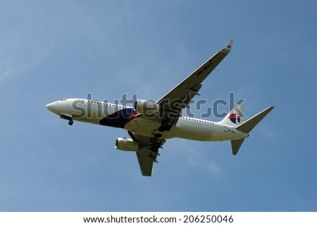 SEPANG, MALAYSIA - JULY 19: Malaysia Airlines plane Boeing 737-800, Registration name 9M-MXJ, ready to landing at KLIA airport on July 19, 2014 in KLIA, Sepang, Malaysia.  - stock photo