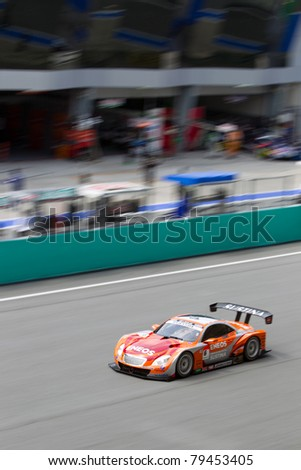 SEPANG, MALAYSIA - JUNE 18: A portrait view of Lexus team leMans Eneos going past the pit lane during qualifying at Super GT International series June 18, 2011 in Sepang, Malaysia - stock photo