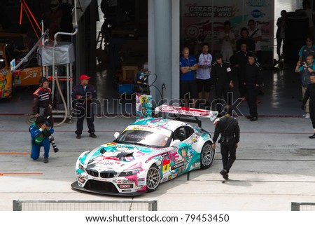 SEPANG, MALAYSIA - JUNE 18: GSR with team Ukyo exits the pit box during qualifying at Super GT International series June 18, 2011 in Sepang, Malaysia. Their team took pole in the GT300 class - stock photo