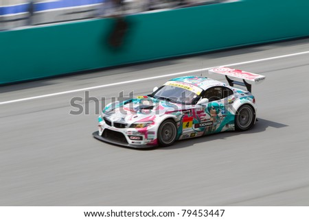 SEPANG, MALAYSIA - JUNE 18: GSR with team Ukyo going past the pit lane during qualifying at Super GT International series June 18, 2011 in Sepang, Malaysia. Their team took pole in the GT300 class - stock photo