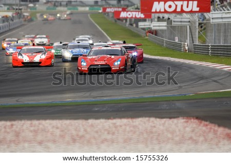 Sepang, Malaysia - June 22, 2008: GT cars at in action during race day at Super GT Malaysia Championship 2008. - stock photo