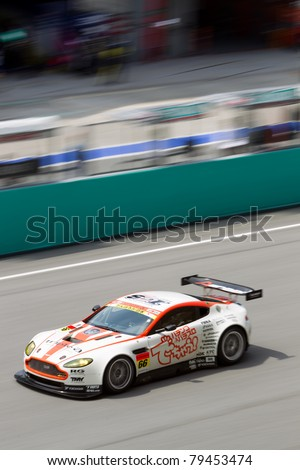 SEPANG, MALAYSIA - JUNE 18: Portrait view of Team A Speed in their Aston Martin going past the pit lane during qualifying at Super GT International series June 18, 2011 in Sepang, Malaysia - stock photo