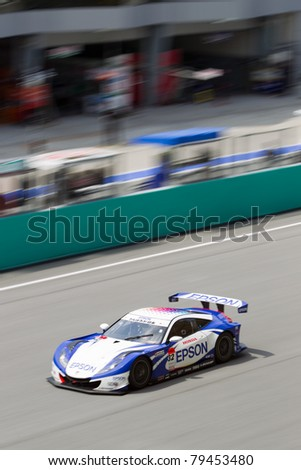 SEPANG, MALAYSIA - JUNE 18: Portrait view of Team Nakajima Racing in their Honda going past the pit lane during qualifying at Super GT International series June 18, 2011 in Sepang, Malaysia - stock photo