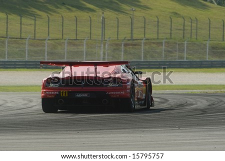 Sepang, Malaysia - June 20, 2008: Rear view of a car from Jimcenter Advan F430 team during practice session at Super GT Malaysia Championship 2008. - stock photo