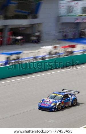 SEPANG, MALAYSIA - JUNE 18: Samurai team Tsuchiya in their Porsche 911 goes past the pit lane during qualifying at Super GT International series June 18, 2011 in Sepang, Malaysia