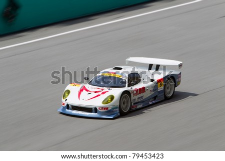 SEPANG, MALAYSIA - JUNE 18: Team Mach in a Vemac car going past the pit lane during qualifying at Super GT International series June 18, 2011 in Sepang, Malaysia - stock photo