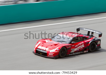 SEPANG, MALAYSIA - JUNE 18: Team Nismo in their Nissan GTR goes past the pit lane during qualifying at Super GT International series June 18, 2011 in Sepang, Malaysia - stock photo