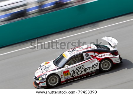SEPANG, MALAYSIA - JUNE 18: Team SG Changi in their Lexus goes past the pit lane during qualifying at Super GT International series June 18, 2011 in Sepang, Malaysia - stock photo