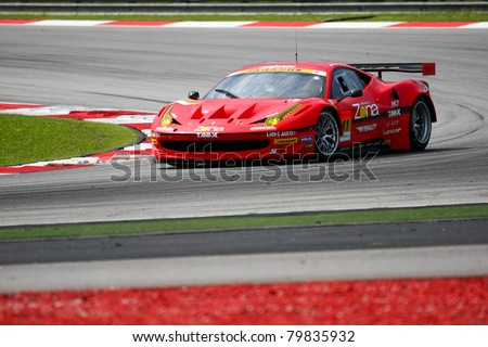 SEPANG, MALAYSIA - JUNE 18: The Ferrari 458 car of Jimgainer puts in some practice laps in the Sepang International Circuit during the Japan SUPER GT Round 3 on June 18, 2011 in Sepang, Malaysia. - stock photo