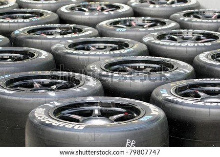 SEPANG, MALAYSIA - JUNE 18: Tires for the race cars are marked and ready for use at the Sepang International Circuit during the Japan SUPER GT Round 3 on June 18, 2011 in Sepang, Malaysia. - stock photo