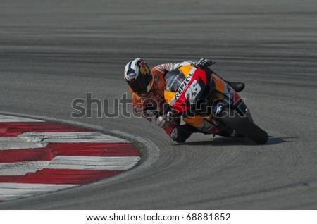SEPANG, MALAYSIA - KUALA LUMPUR, MALAYSIA - FEBRUARY 4: Dani Pedrosa of Spain at the MotoGP pre-season testing on February 4, 2010 at the Sepang International Circuit near Kuala Lumpur, Malaysia. - stock photo