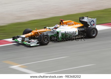 SEPANG, MALAYSIA - MARCH 23: British Paul di Resta of Team Sahara Force India exits turn 15 during Friday practice at Petronas Formula 1 Grand Prix March 23, 2012 in Sepang, Malaysia - stock photo