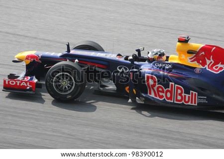 SEPANG, MALAYSIA - MARCH 23: Close -up Sebastian Vettel of Red Bull Racing in action during Petronas Malaysian Grand Prix practice session at Sepang F1 circuit on March 23, 2012 in Sepang, Malaysia. - stock photo