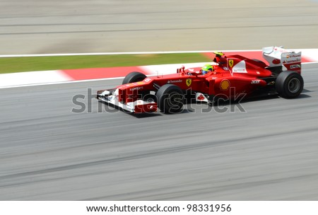 SEPANG, MALAYSIA - MARCH 23 : Ferrari Team driver Felipe Massa action on track during Petronas Malaysian Grand Prix second practice session at Sepang F1 circuit March 23, 2012 in Sepang - stock photo