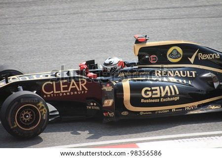 SEPANG, MALAYSIA - MARCH 23: Finnish Kimi Raikkonen of Lotus-Renault in action during Friday practice at Petronas Formula 1 Grand Prix on March 23, 2012 in Sepang, Malaysia - stock photo