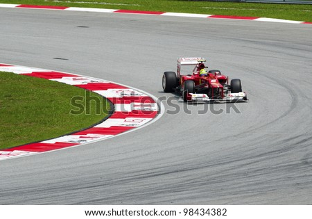 SEPANG, MALAYSIA-MARCH 23 : Formula One driver Felipe Massa of Scuderia Ferrari Team races during the first practice session on March 23, 2012 in Sepang International Circuit in Sepang, Malaysia. - stock photo