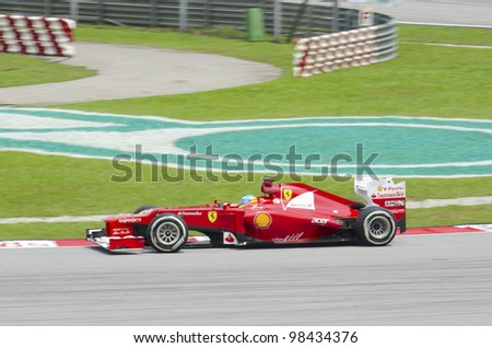 SEPANG, MALAYSIA-MARCH 23 : Formula One driver Fernando Alonso of Scuderia Ferrari Team races during the first practice session on March 23, 2012 in Sepang International Circuit in Sepang, Malaysia.