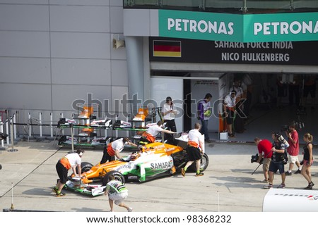 SEPANG, MALAYSIA - MARCH 23: German Nico Hulkenberg of Team Sahara Force India pushed back to pit after Friday practice at Petronas Formula 1 Grand Prix March 23, 2012 in Sepang, Malaysia - stock photo