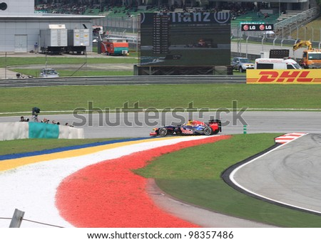 SEPANG, MALAYSIA - MARCH 23: German Sebastian Vettel of Red Bull Racing-Renault in action during Friday practice at Petronas Formula 1 Grand Prix on March 23, 2012 in Sepang, Malaysia - stock photo