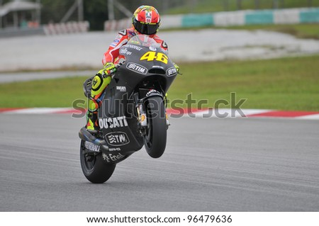 SEPANG, MALAYSIA-MARCH 1:Italian Valentino Rossi of Ducati Team pulls a wheelie at the 2nd MotoGP winter testing on Mar. 1, 2012 in Sepang, Malaysia. The 2012 MotoGP season starts on April 8 in Qatar.