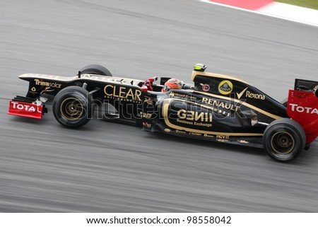 SEPANG, MALAYSIA - MARCH 23 : Lotus-Renault Team driver Romain Grosjean in action during Petronas F1 Malaysian Grand Prix practice session at Sepang F1 circuit on March 23, 2012 in Sepang,Malaysia. - stock photo