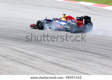 SEPANG, MALAYSIA - MARCH 23: Mark Webber of Red Bull Racing Team braking at corner during Friday practice at Petronas Formula 1 Grand Prix on March 23, 2012 in Sepang, Malaysia - stock photo