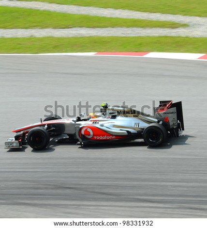 SEPANG, MALAYSIA - MARCH 23 : McLaren-Mercedes Team driver Lewis Hamilton action on track during Petronas Malaysian Grand Prix second practice session at Sepang F1 circuit March 23, 2012 in Sepang - stock photo