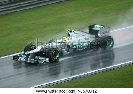 SEPANG, MALAYSIA - MARCH 25: Nico Rosberg of Mercedes GP Petronas team in action during rain at Formula One PETRONAS Malaysian Grand Prix at Sepang F1 Circuit on 25 March, 2012 in Sepang, Malaysia. - stock photo
