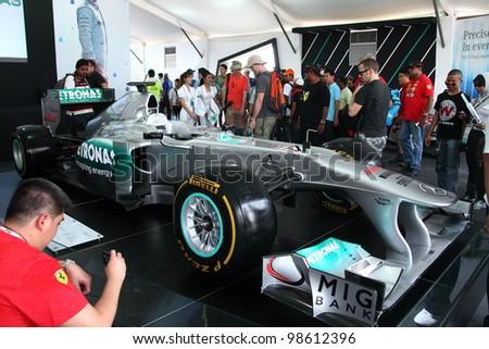 SEPANG, MALAYSIA-MARCH 25 : Petronas Mercedes GP F1 racing car on display during the Malaysian F1 Grand Prix on March 25, 2012 in Sepang International F1 Circuit,Sepang, Malaysia. - stock photo