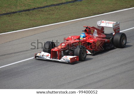 SEPANG, MALAYSIA - MARCH 23: Spanish Fernando Alonso of Ferrari in action during Friday practice at Petronas Formula 1 Grand Prix on March 23, 2012 in Sepang, Malaysia - stock photo