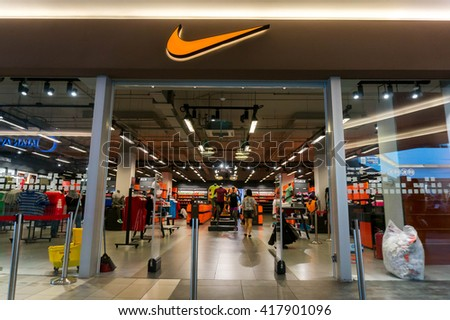 SEPANG, MALAYSIA - MAY 8, 2016: Nike retail outlet. Nike is one of famous sports fashion brands worldwide and it is one of the world's largest suppliers of athletic shoes and apparel. - stock photo