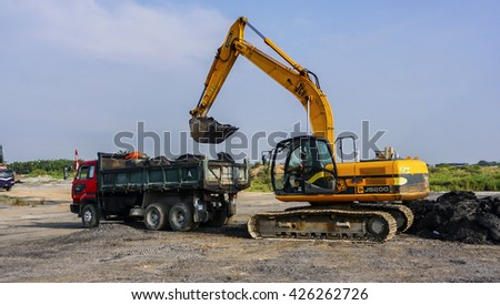 Sepang, Malaysia 14 May 2016, Yellow excavator on a construction site against blue sky - stock photo