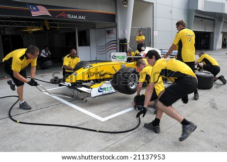 Sepang, Malaysia - November 21: Malaysian Team Pit Crew, Practice changing the tyre in the Malaysian A1Grand Prix,  Round 3 2008-2009 Session. - stock photo
