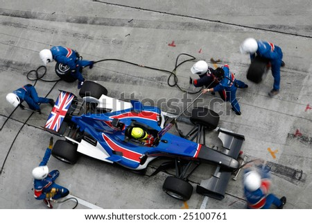 Sepang, MALAYSIA - 21 November: Pit crew of Team Great Britain in action at the World A1 GP championship races held in Malaysia. 21 November 2008 in Sepang International Circuit Malaysia. - stock photo