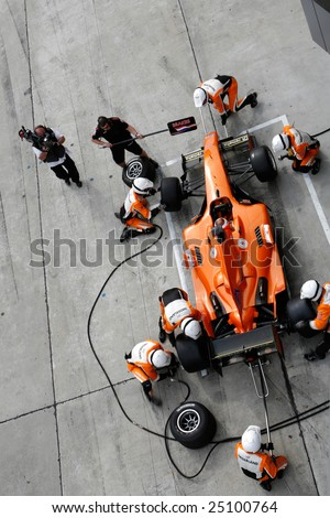 Sepang, MALAYSIA - 21 November: Pit crew of Team Nederlands in action at the World A1 GP championship races held in Malaysia. 21 November 2008 in Sepang International Circuit Malaysia. - stock photo