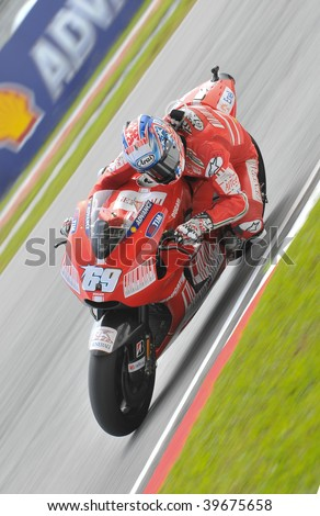 SEPANG, MALAYSIA - OCT 25 : American Nicky Hayden of Ducati Marlboro Team negotiates a corner during warm up session at Shell Advance Malaysian Motorcycle Grand Prix on October 25, 2009 in Sepang.