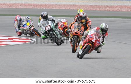 SEPANG, MALAYSIA - OCT 25 : 125cc riders in action at race day at Shell Advance Malaysian Motorcycle Grand Prix on October 25, 2009 in Sepang. Julian Simon of Bancaja Aspar Team won the race. - stock photo