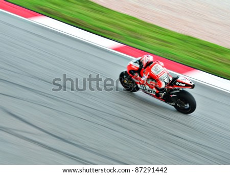SEPANG, MALAYSIA - OCTOBER 21: Italy MotoGP rider Nicky Hayden of Ducati Team in motion blur during a free practice session on October 21, 2011 at Sepang International Circuit, Sepang, Malaysia - stock photo