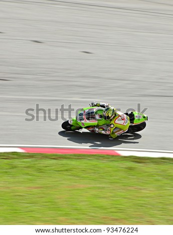 SEPANG, MALAYSIA - OCTOBER 21: Moto GP Loris Capirossi from Pramac Racing Team in action during MotoGP Test Day at Sepang International Circuit on October 21, 2011 in Sepang, Malaysia. - stock photo