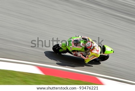 SEPANG, MALAYSIA - OCTOBER 21: Moto GP Rider Randy De Puniet from Pramac Racing Team in action during MotoGP Test Day at Sepang International Circuit on October 21, 2011 in Sepang, Malaysia. - stock photo