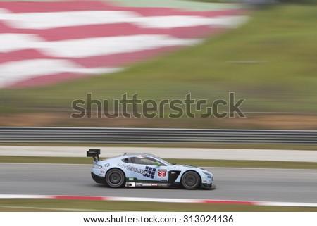 Sepang, Malaysia - September 4, 2015 : British Aston Martin car no 88 exits turn 2 at Asian Festival of Speed Race, Sepang, Malaysia  - stock photo