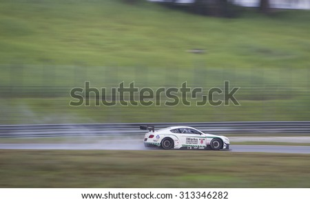 Sepang, Malaysia - September 5, 2015 : British Bentley car no 8 drives in the wet at Asian Festival of Speed Race, Sepang, Malaysia  - stock photo