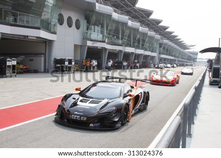 Sepang, Malaysia - September 4, 2015 : British McLaren car no 55 exits pit lane at Asian Festival of Speed Race, Sepang, Malaysia  - stock photo