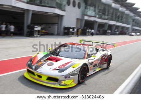 Sepang, Malaysia - September 4, 2015 : Ferrari Car No 1 exits pit lane at Asian Festival of Speed Race, Sepang, Malaysia  - stock photo