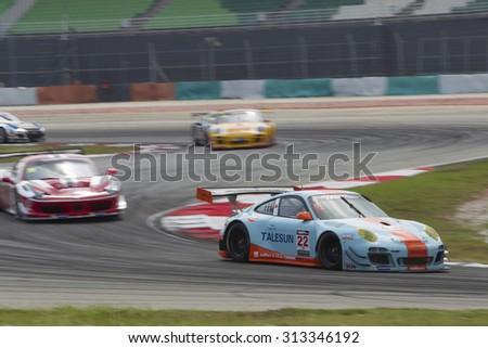 Sepang, Malaysia - September 5, 2015 : German Porsche car no 22 exits turn 2 at Asian Festival of Speed Race, Sepang, Malaysia  - stock photo