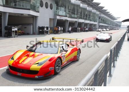 Sepang, Malaysia - September 4, 2015 : Italian Ferrari Car No 37 exits pit lane at Asian Festival of Speed Race, Sepang, Malaysia  - stock photo