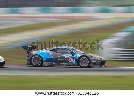 Sepang, Malaysia - September 5, 2015 : Italian Ferrari Car No 27 exits turn 2 at Asian Festival of Speed Race, Sepang, Malaysia  - stock photo