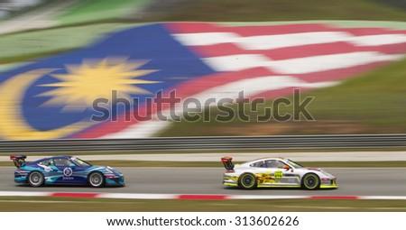 Sepang, Malaysia - September 4, 2015 : Team Jebsen car 20 chases car 12 in turn 3 at Porsche Carrera Cup Asia AFOS, Sepang, Malaysia - stock photo